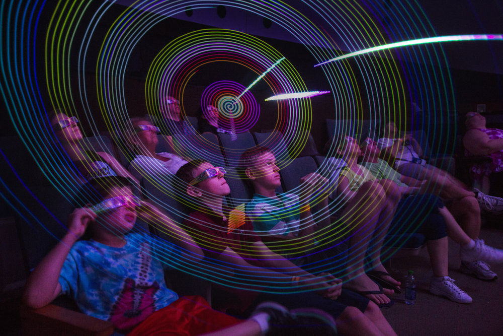 In this double-exposure photo, the audience watches a laser light show set to the music of Metallica at the Calusa Nature Center & Planetarium in Fort Myers on Sunday, June 18, 2017.