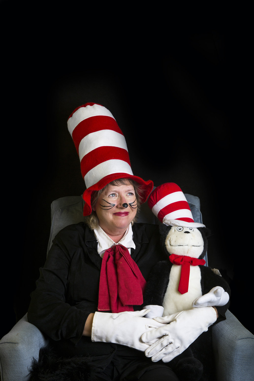 Connie Bettinger-Hennink, 53, dressed as Dr. Seuss' iconic character Cat in the Hat, poses for a portrait in her Golden Gate home on Tuesday, Dec. 20, 2016. For the past 25 years, Connie has visited schools and libraries in Southwest Florida as a Cat in the Hat reenactor to share the joys of reading.