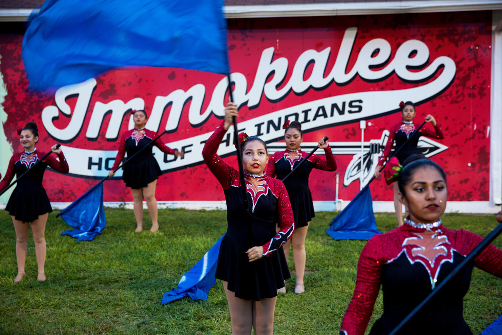 The Immokalee Indians color guard practices before the halftime show of the Harvest Bowl matchup at Gary Bates Stadium in Immokalee, Florida on Friday Sept. 2, 2016. The Tigers defeated the Indians 20-17.