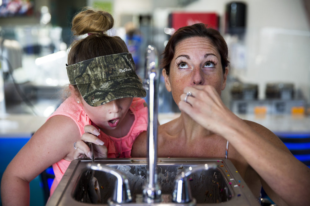 Maille Duffy, 8, left, opens her mouth in shock as her mom, Samantha Duffy, finishes her last spoonful of ice cream during the Where to Eat 239 Kitchen Sink Challenge at Royal Scoop Homemade Ice Cream at Berkshire Place in East Naples on Monday, July 24, 2017. The food challenge requires participants to finish around 6 pounds of ice cream, waffle cones and various toppings in one hour.
