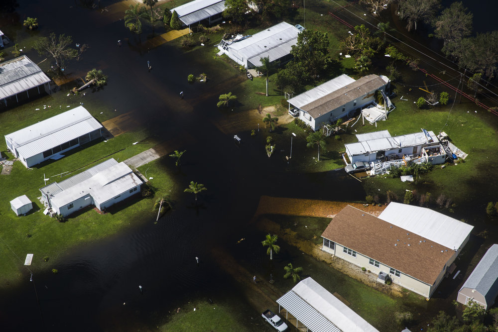 Flood waters fill the streets of Imperial Bonita Estates, a mobile home park, in Bonita Springs on Saturday, Sept. 16, 2017, six days after Hurricane Irma.