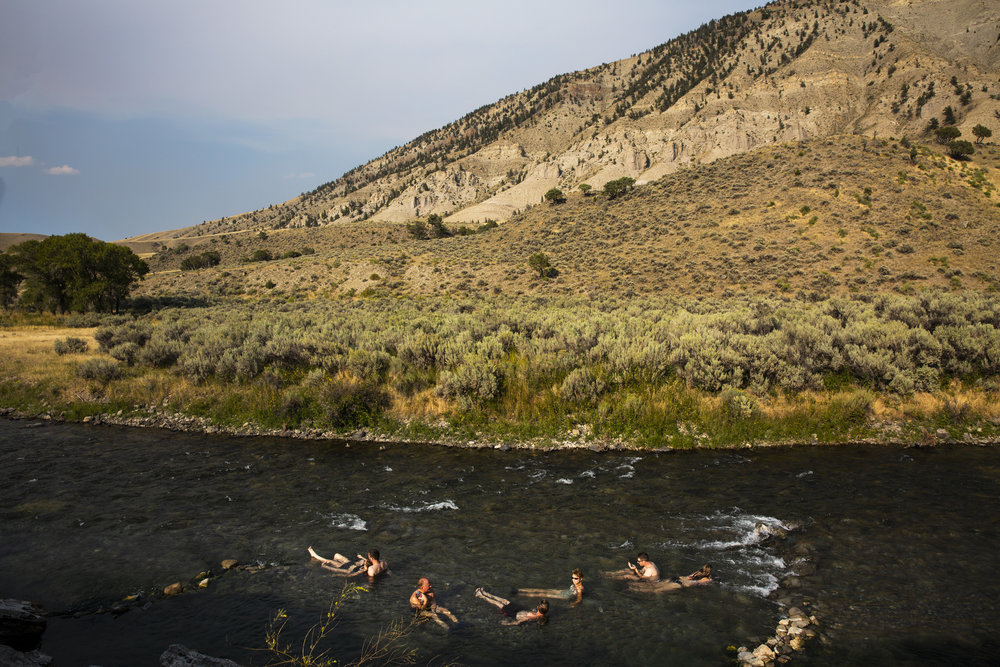 Swimmers soak in the Boiling River outside Mammoth, Wyoming in Yellowstone National Park. 2018