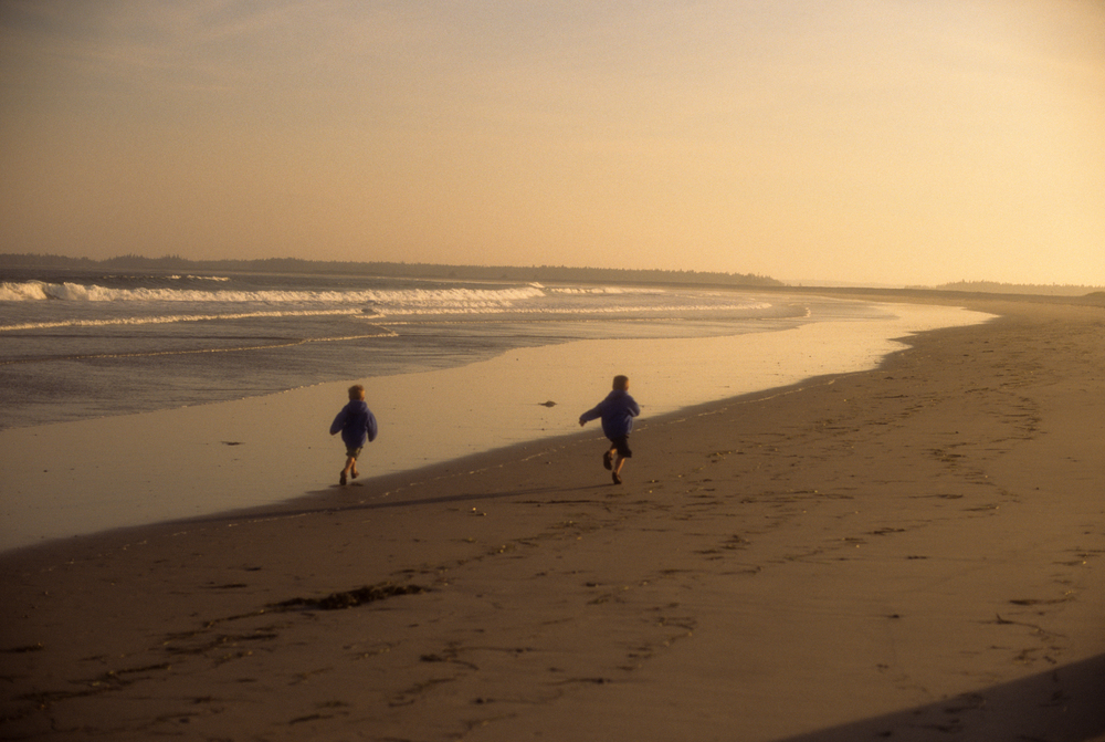 Boys running on cherry hill beach.jpg