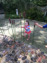 Nora playing in the Children's Garden