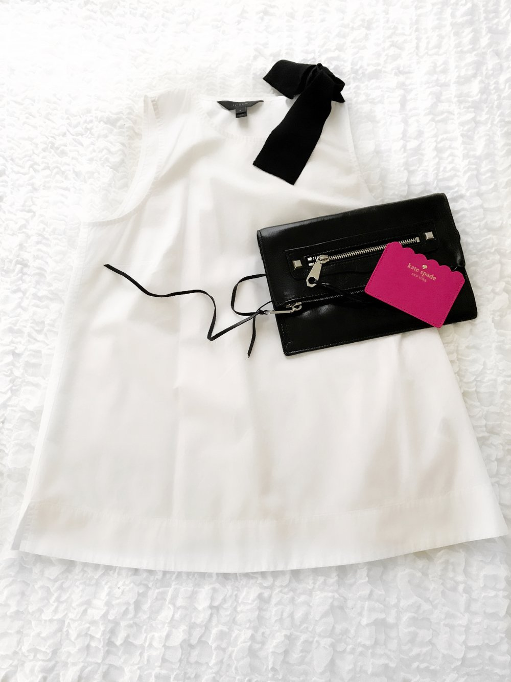 I shy away from white shirts that need to be dry-cleaned when with my kids, so it's time to break it out of my closet! This is J Crew holiday, but a cute option is here. This Rebecca Minkoff bag is great- it can be worn as a clutch or cross body. The Kate Spade card holder works as the perfect sized wallet.