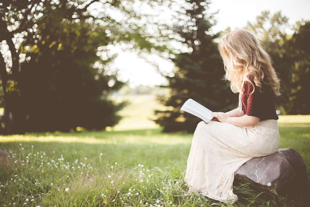 unsplash blonde high school girl reading outdoors.jpg