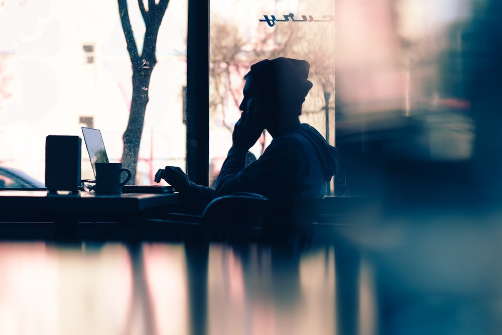 unsplash boy studying coffee shop.jpg