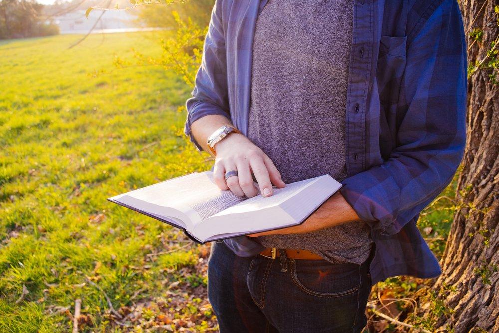 unsplash boy reading outdoors no face.jpg