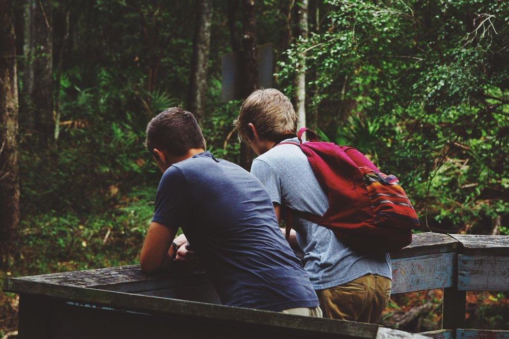 unsplash boys backpack woods no face.jpg