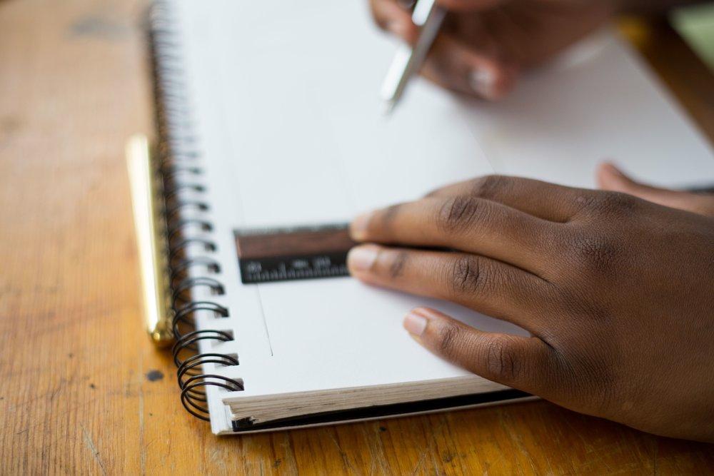 unsplash geometry ruler notebook hands.jpg