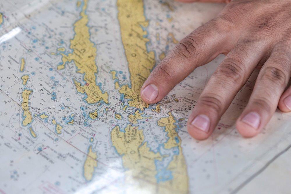 unsplash map fingers.jpg