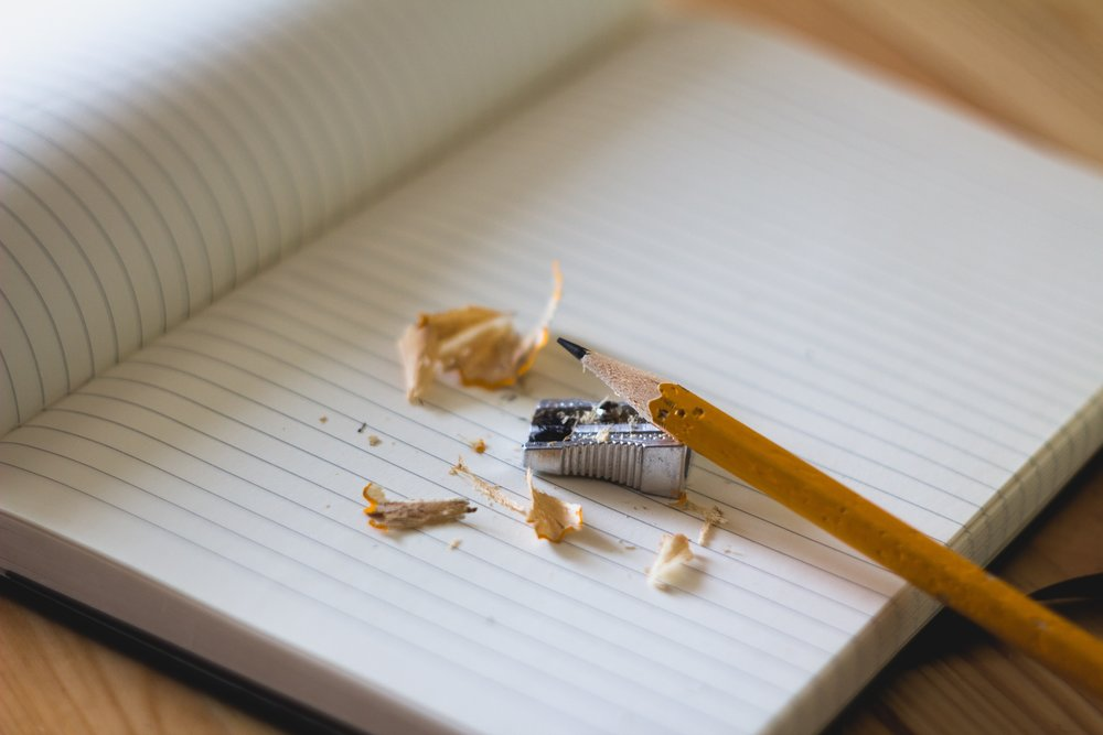 unsplash pencil sharpener notebook.jpg