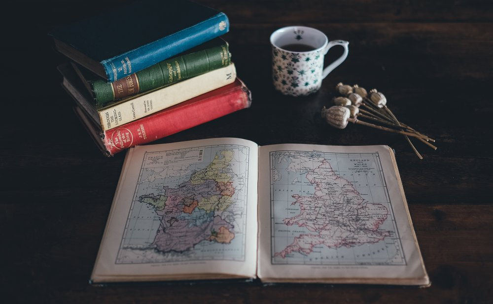 unsplash vintage books coffee flowers map.jpg