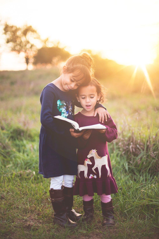 unsplash small girls reading outdoors.jpg