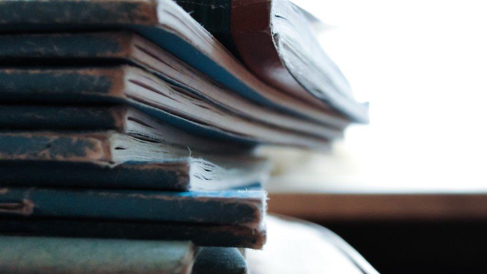 unsplash worn bluebooks.jpg
