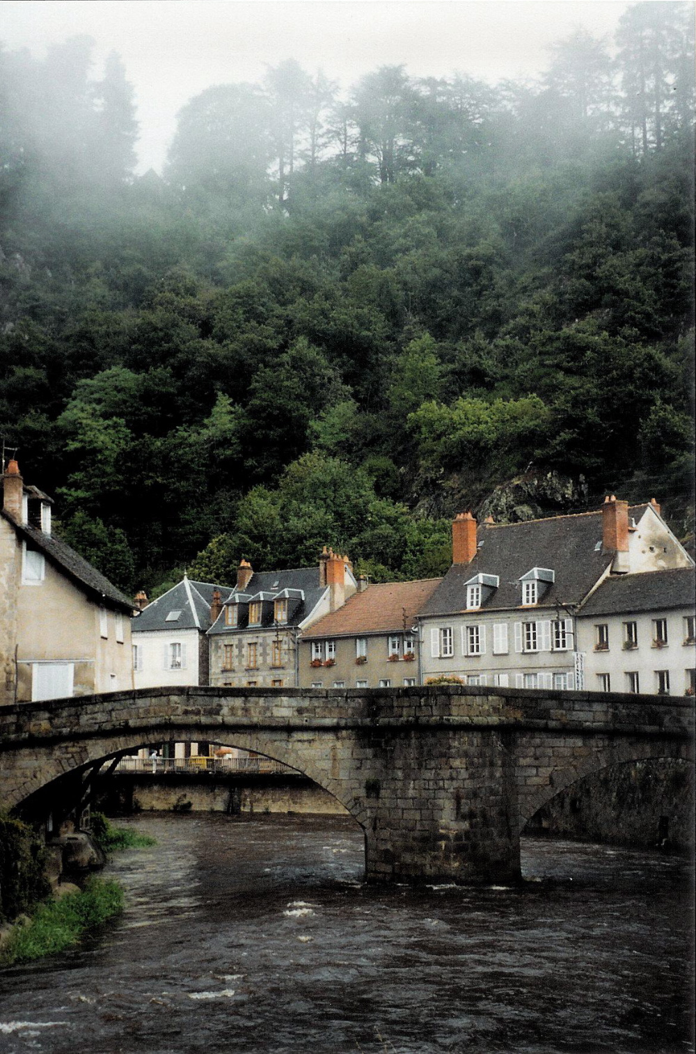 Medieval bridge over the Creuse River in Aubusson, France