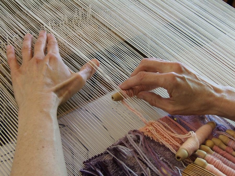 Elizabeth Buckley's hands weaving photo credit: Lany Eila