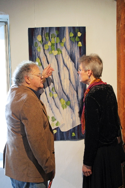 Archie Brennan, Elizabeth Buckley discussing design process  with her tapestry Dialogues Through the Veil. Photo credit: Lisa Heilman Lomauro