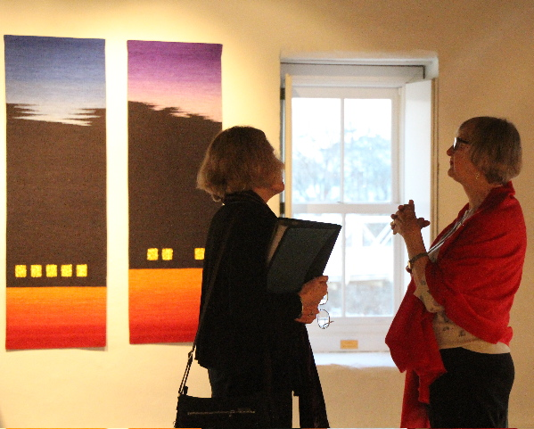 Carol K. Russell and Linda Wallace conversing in front of  Rebecca Bluestone's Landscape Series:  Triptych #2.  Photo credit:  Lisa Heilman Lomauro