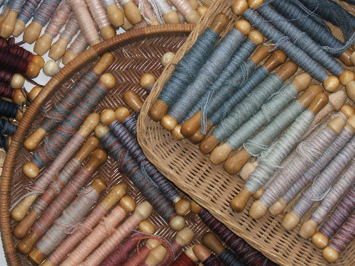 Partial palette of wound bobbins    Photo credit:  Elizabeth Buckley  ©2015
