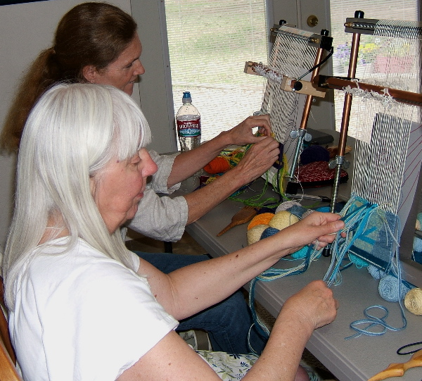 Marilyn and Debbie at their looms
