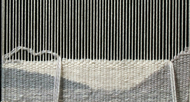 Weaving with Blend A, filling in the short and longer steps created with the solid white.  This is another way to weave irregular hatching.
