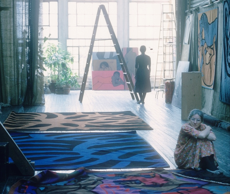 Marianne and Annabert Yoors with tapestries in the Forty-seventh Street studio.          Photo courtesy of Debra Dean and Yoors Family Archives