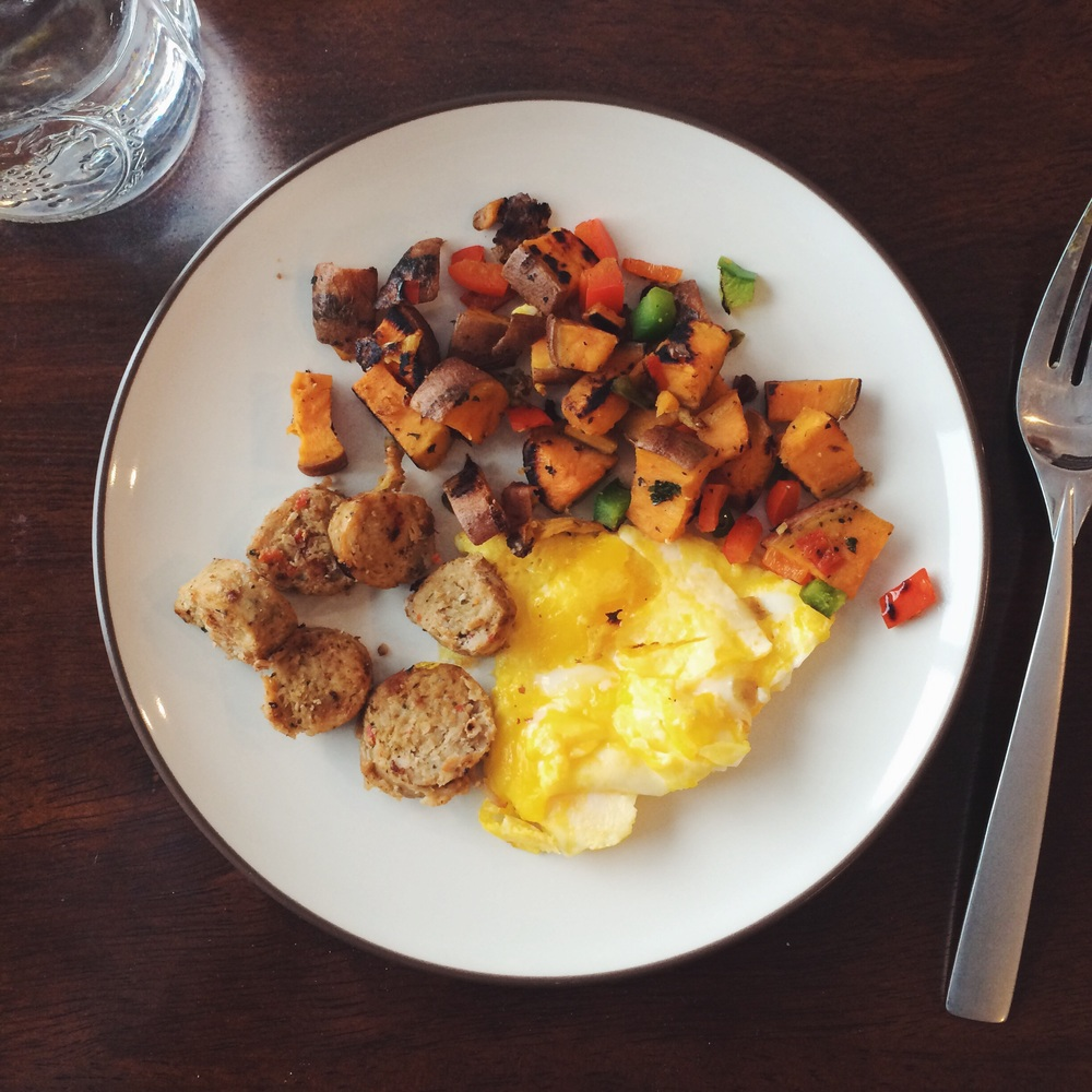 Roasted red pepper & garlic turkey sausage, scrambled eggs cooked in coconut oil, and sweet potatoes.