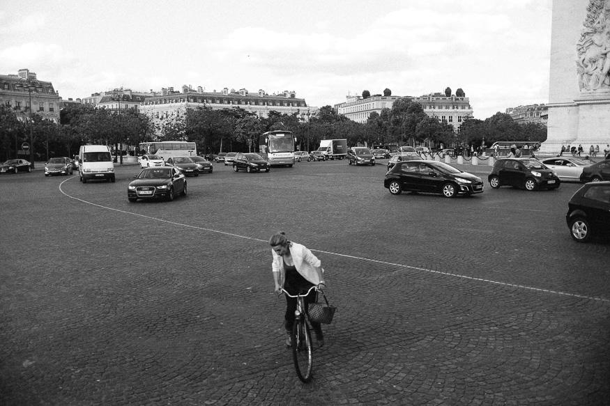Woman cycling on the Arc de Triomphe, Paris, France.