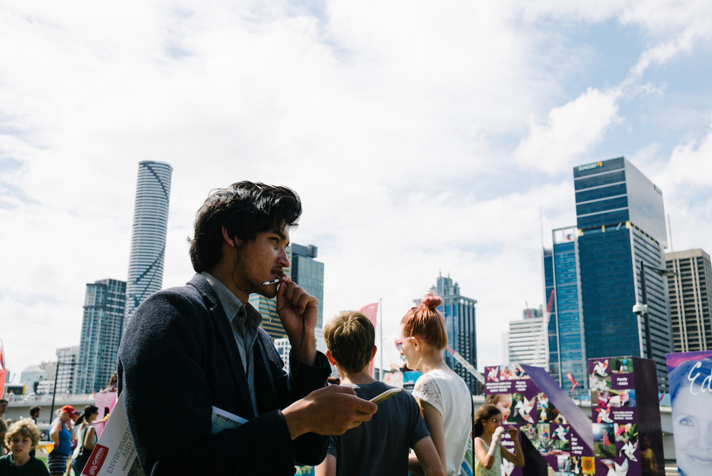 Nick-Bedford-Photographer-Student-talking-on-microphone-South-Bank-Brisbane-Street-Photography.jpg