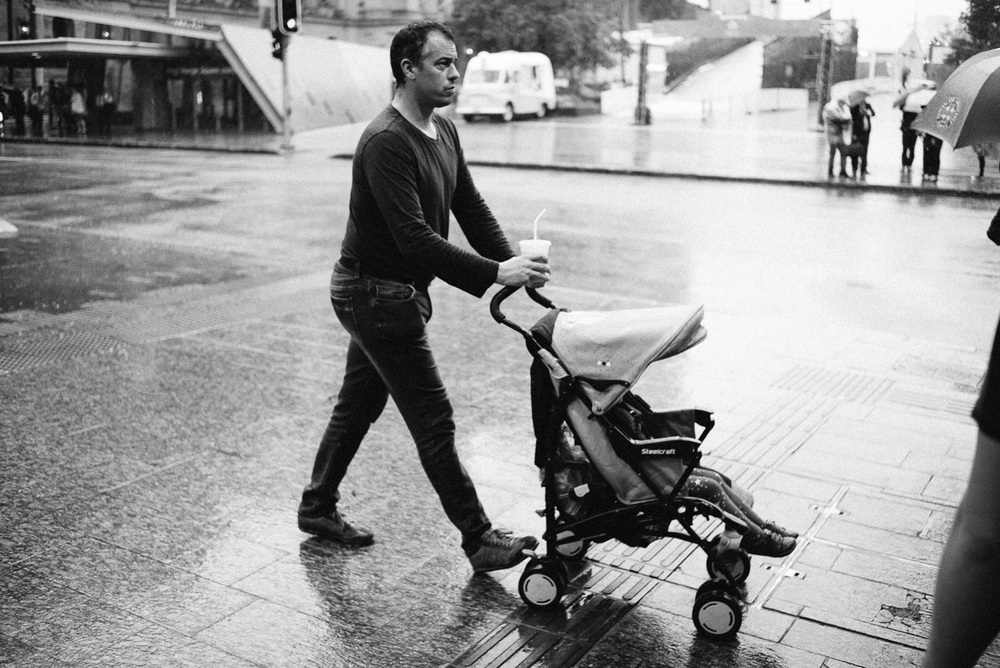 Dad racing his child through the rainy parts.