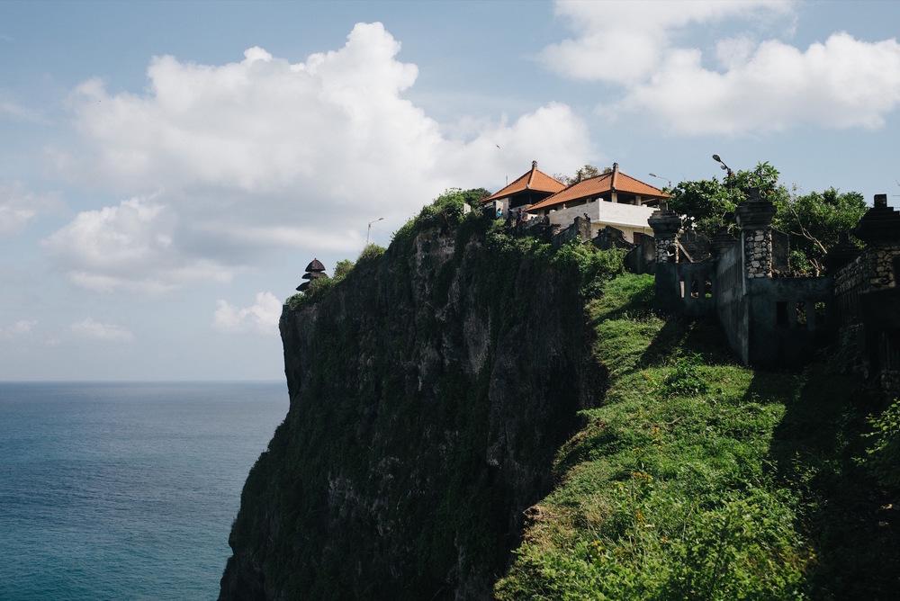 Uluwatu Temple along the cliff edge.