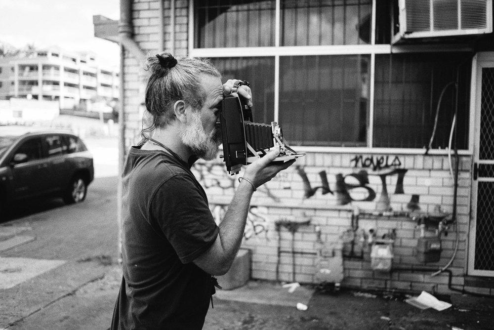 Simon making a 5x4 black and white portrait of Zoe on his Polaroid Razzle conversion.