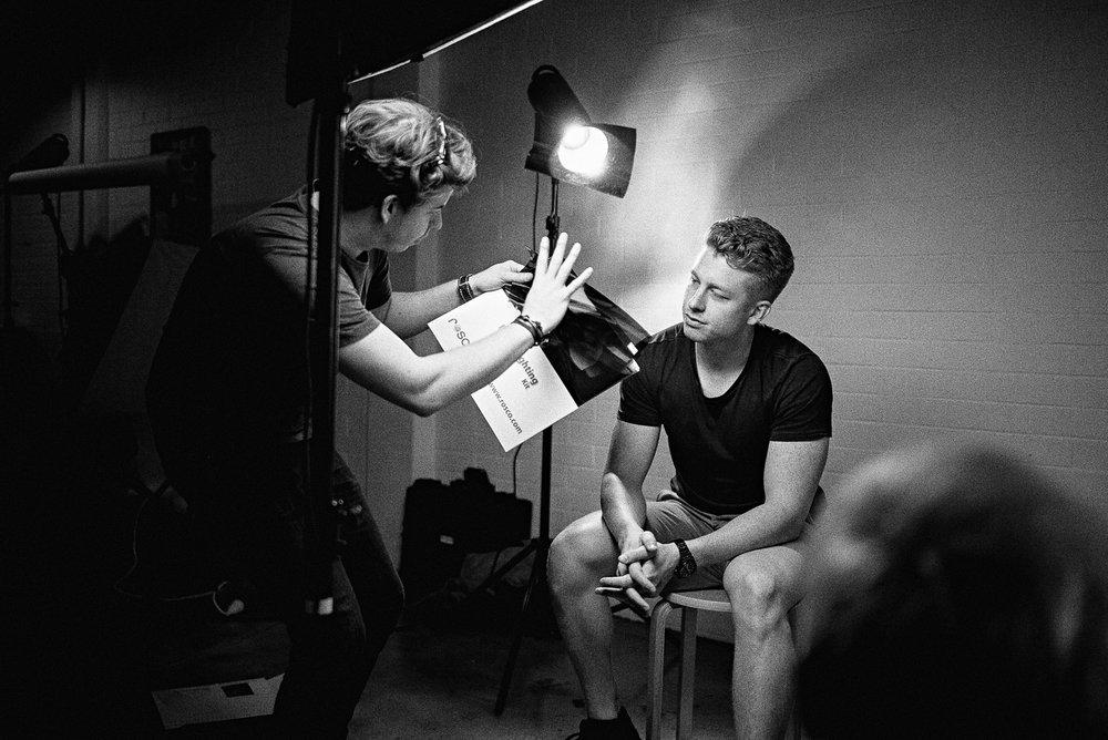Tyler Alberti teaching a portrait lighting workshop.