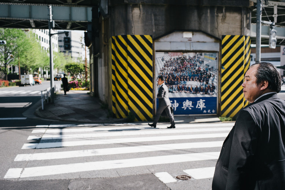 Stripes,stripes and slick hair near the Ryogoku railway station.
