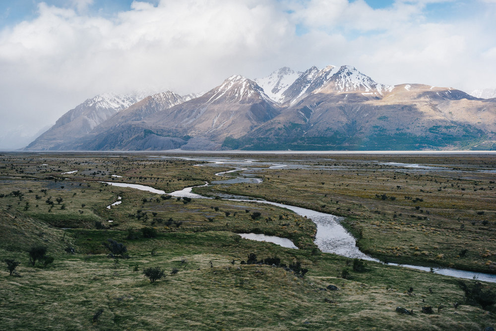 Meltwater rivers flowing through Mount Cook National Park park from the Tasman glacier towards Lake Pukaki.