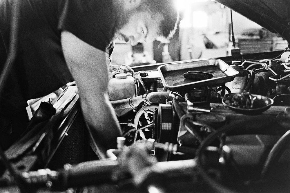Jason fixing stuff in his 4WD.