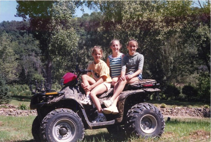 Riding ATVs at the end of a daddy-daughter canoe trip