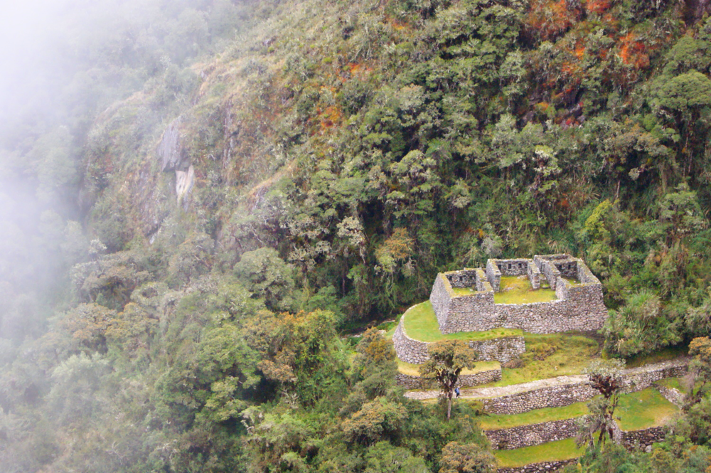 Day 3 - Seeing some incredible Incan Ruins dotted along the trail, they peak out from behind clouds!