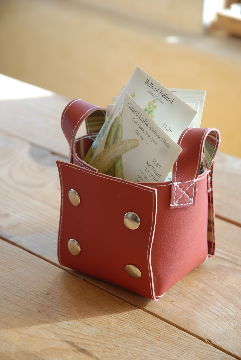 little red bin with seed packs.jpg