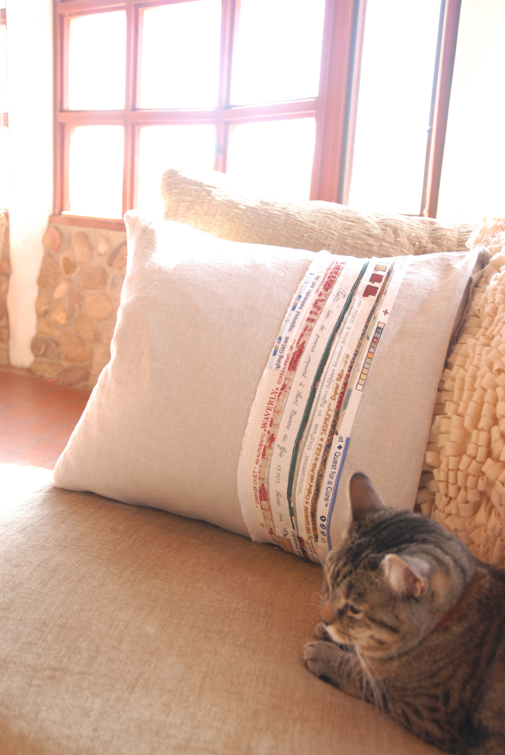 finished selvedge pillow with cat light.jpg