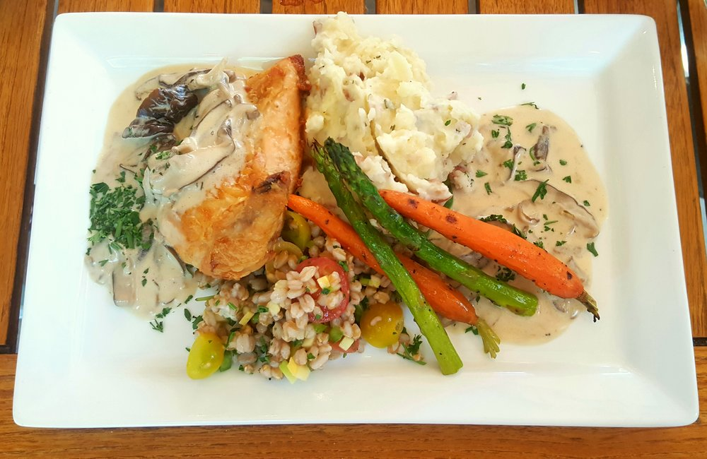 Mushroom Chicken: chicken breast served with farro onion mushroom salad, mashed potatoes, and a creamy wild mushroom sauce