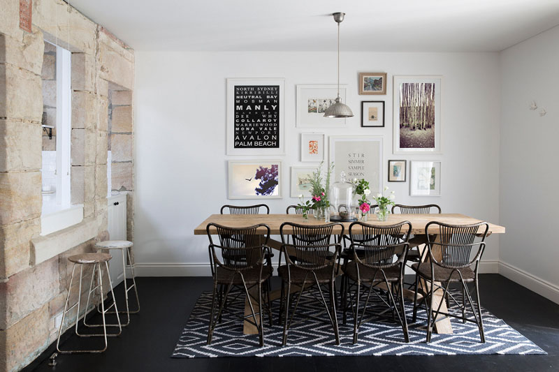 Original image from Desire to Inspire blog.   I can totally see my print on the left working in this space.  I love this dining room, the mix of the stone wall, graphic print rug and the gallery art wall.  The birch tree print on the top right is also an image of mine.