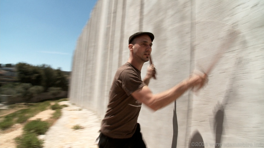 Robbert Van Hulzen plays the Israeli separation barrier near Bethlehem