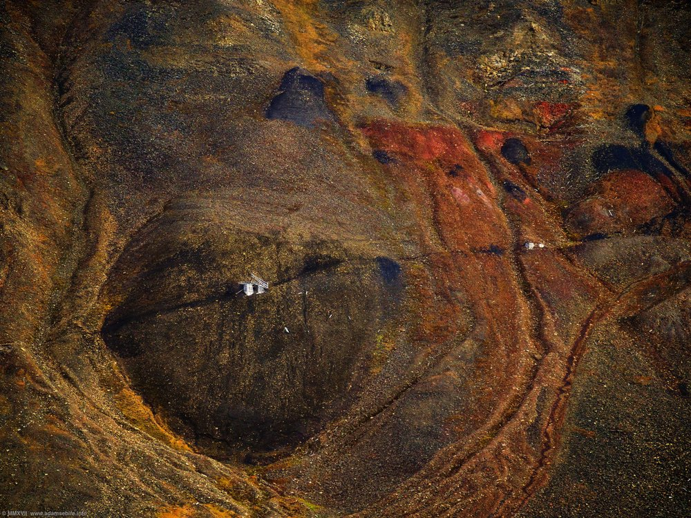 "In the Eye of the Anthropocene  The remains of the aerial cable-way for coal mine nº2B, ""Santa Claus Mine"", surrounded by oxidised mineral spoil on a mountain in Nybyen, Svalbard, some 1200km from the North Pole. ©18 September 2017 Adam Sébire. 78.205280ºN, 15.611418ºE"