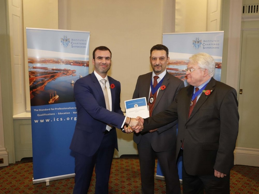 Mr Lambrou receives his award by Mr M Taliotis, ICS International Chairman and Mr  K Franz, Chairman, Chairman of ICS Membership Committee.
