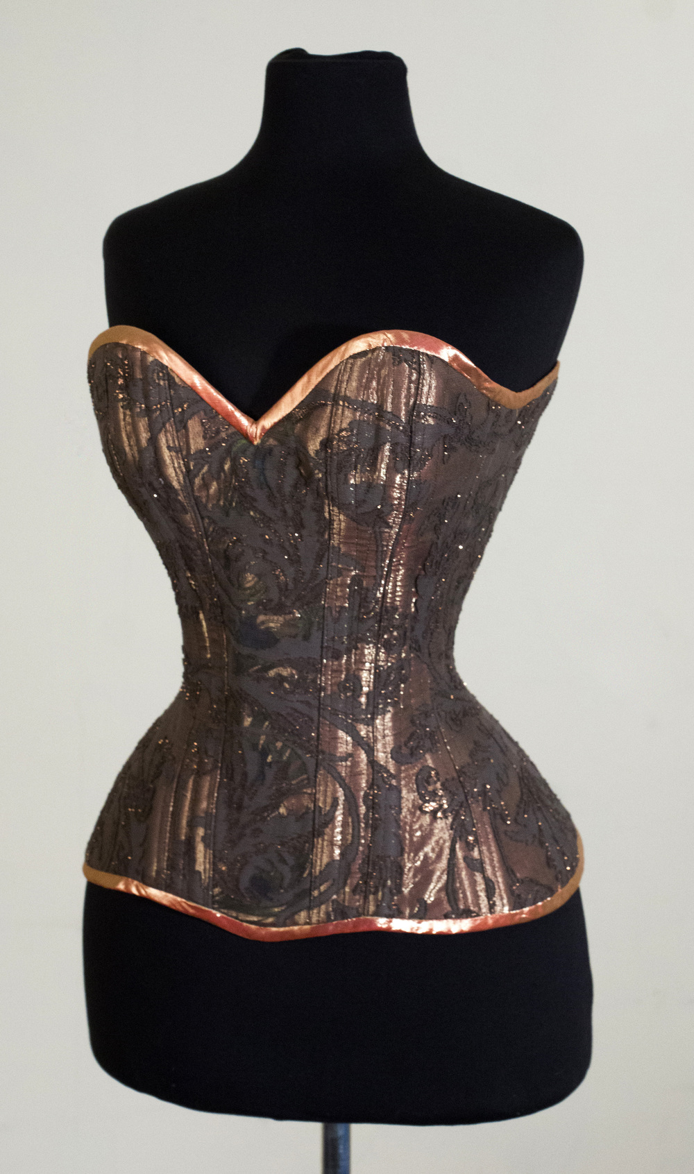 A Crikey Aphrodite corset using cotton madras from MYB overlaid on copper metallic silk.