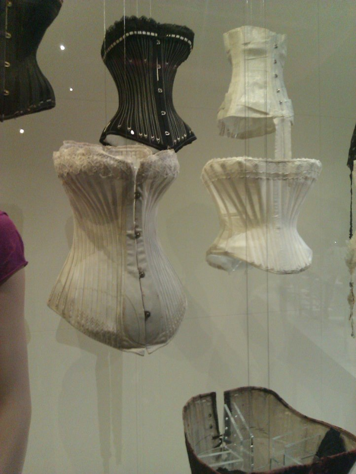 "Centre-left: the antique ""Birds Wing"" corset, copyright Snibston Discovery Museum, Coaville."