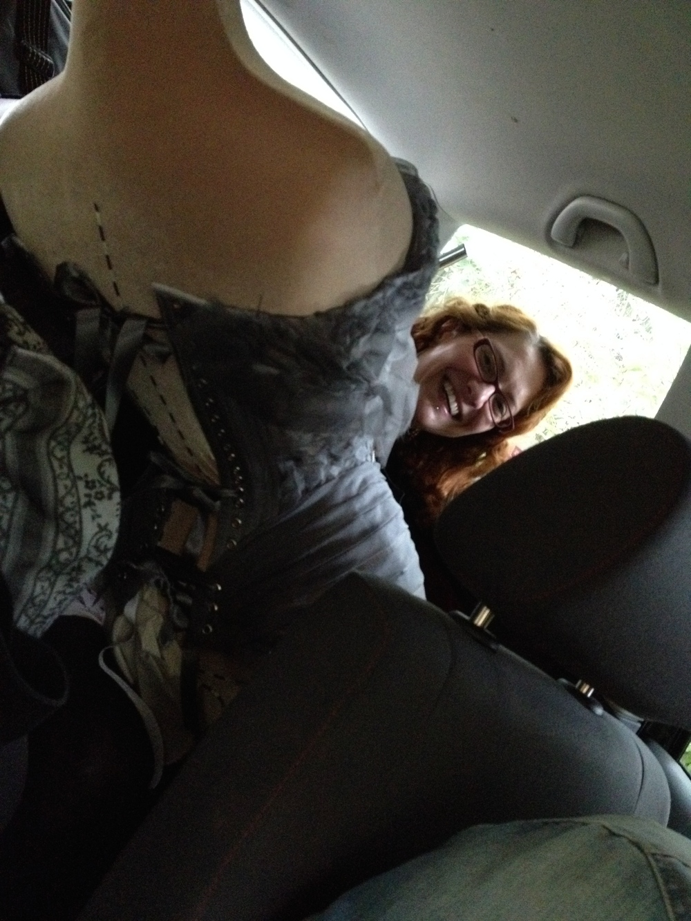 Actually Gerry never really stopped making her Jesus Corset, until the moment she needed it!  Here she is in the packed car on the way to Jesus, needle in hand.