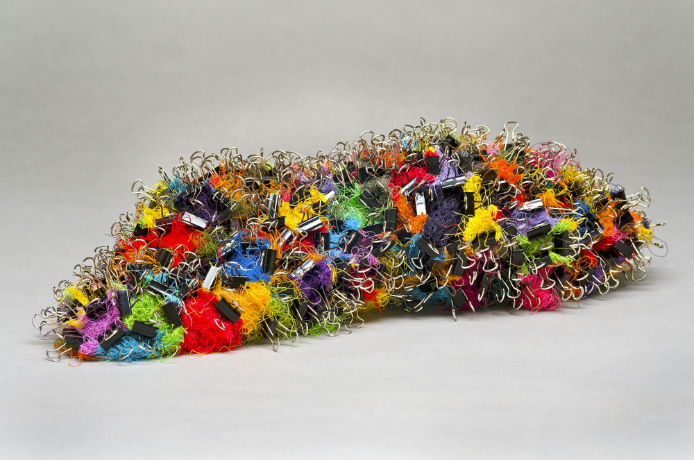 "Crawl , 2014 thread, binder clips 6"" x 20"" x 8"""